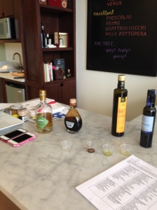 Precious liquids on the marble tasting counter at Olio2go, a new public group site in Fairfax.